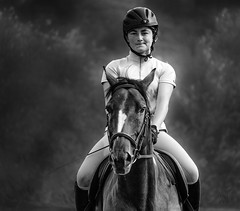 failing a jump... as you can tell from the face of the young rider (marianna_a.) Tags: p1430949 equestrian horse jumping young female girl rider portrait monochrome monday mariannaarmata