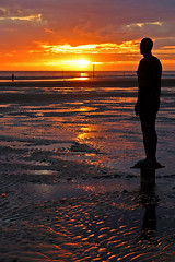Sunset at The Gormleys (Nigel Valentine) Tags: gormley crosby sunset sand sea sillhouette