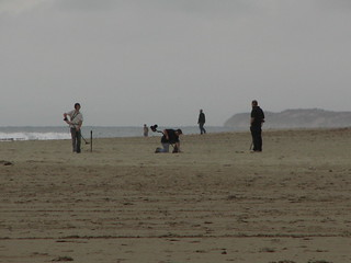beach people with metal detectors  sea mountains