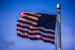 God bless (Bluuegypsy) Tags: america flag sky blue canon eos 200mm lens telephoto lcwphoto red white stripes stars banner freedom land free prime shot exposure shots creator class colors rebel t3i photography digest usa