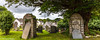 St Peters Graves (PRPhoto dot Wales) Tags: lampetervelfrey pembrokeshire stpeters wales flowers gravestones graveyard houses photograph prphotowales rural tombstones travel trees village yew nothdr nofilters lightroom weathervane overcast cloudy bright