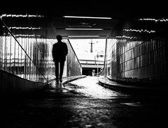 Man out of the Light (Blackbossa) Tags: black white blackandwhite whiteandblack surreal man shadow intothesun hamburg steinstrase trainstation guy light germany tunnel streetlife streetphotography streetscene streetart street