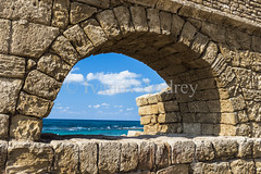 Waves of the sea in ancient arch (Ivanov Andrey) Tags: aqueduct christianity series crusader archaeology history ruins wall sun arch shadow light fence sea noon wave wind sky cloud plant space outdoor color straightline shore stone block brick museum architecturalelement antique corner vertical horizontal perspective themediterraneansea caesarea thesea israel