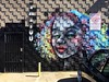Mosaic (misterbigidea) Tags: business colorful window reflection squares mosaic portrait face beauty urban city street mural graffiti painted artwork art wall building cinderblock entrance sign shop parlor tattoo