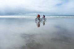 Skyride (lilyshot) Tags: bikes beach reflection wetbeach