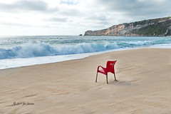 Blowing Sand (joeinpenticton Thank you 1.4 Million + views) Tags: blowing sand beach nazare portugal wave waves chair sical coffee espresso lighthouse light house pacific ocean red plastic