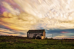 Colour Pockets (Matt Molloy) Tags: mattmolloy timelapse photography timestack photostack movement motion orange sky sunset clouds trails grass field fence barn countryside rural bath ontario canada landscape lovelife
