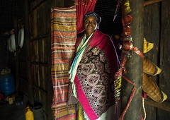 Gurage woman inside her traditional house, Gurage Zone, Butajira, Ethiopia (Eric Lafforgue) Tags: abyssinia adult africa architecture art butajira clothing culture decorated decoration depiction developingcountry eastafrica ethiopia ethiopia0617427 ethnic gurage homeinterior horizontal hornofafrica house hut indigenousculture indoors lookingatcamera onepersononly onewomanonly portrait poverty realpeople ruralscene toukoul traditional tukul guragezone et
