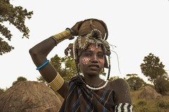 Mursi Woman (Rod Waddington) Tags: africa african afrique afrika äthiopien ethiopia ethiopian ethnic etiopia ethnicity ethiopie etiopian omo omovalley outdoor outdoors omoriver mursi tribe tribal traditional woman portrait people painted face female beads huts mago trees culture cultural