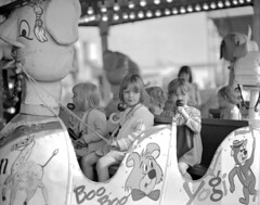 Eating toffee apples at the Hoppings (Tyne & Wear Archives & Museums) Tags: thehoppings newcastletownmoor newcastleupontyne festival funfair children childhood rides yogibear fairground toffeeapples fun carefree enjoyment socialhistory northeastofengland unitedkingdom archives digitalimage interesting unusual fascinating child seated june1973 seat fair land temperancefestival 1882 annualgathering event entertainment festivities rope dress jumper animal lights globe glass blur mark bolt eye hair drawing design artanddesign abstract characters animals bells strap decoration leasure amusement treats glitter components blackandwhitephotograph summerracemeeting gosforthpark