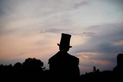 Topper (Ivan Rigamonti) Tags: festival openair zurich festivalground sunset hinwil street evening switzerland colors silhouette bluehour europe sky clouds streetphotography zürich schweiz ch standing hat man topper