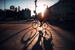 Race the oncoming night (ewitsoe) Tags: canon eos5ds sigmaart35mm 14 bike street city urban womanriding bicycle cityscape poznan europe polska spring warm sunset sun sunny warmth glow lady riding citybike sidewalk ewitsoe erikwitsoe shadows long poland