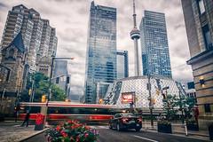 Towering (Paul Flynn (Toronto)) Tags: toronto roythompsonhall city downtown traffic transit ttc torontotransitcommission kingstreet cntower clouds