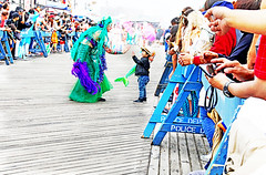 His first love was a mermaid and he'll never be the same again. (kirstiecat (on vacation...)) Tags: mermaid nyc newyorkcity mermaidparade float people happy fun usa america canon street brooklyn coneyisland boy magical poetry urbanpoetry