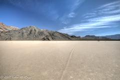 Rock tracks into the desert mountains (taharaja) Tags: cactus california deathvalley desert furnacecreek ghosttown jeeping lowestpoint nationalpark offroad oldtown racetrack sealevel zabriskiepoint lakebed movingstones slatflats unitedstates
