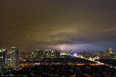Sleepless in Manila (Sumarie Slabber) Tags: lightning thinder storm eyeofthestorm clouds manila philippines landscape city buildings skyscrapers night glow sumarieslabber weather epic