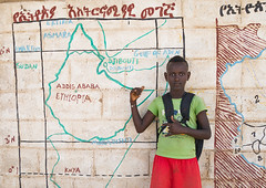 Nyangatom tribe boy in front of a school mural depicting the map of east africa, Omo valley, Kangate, Ethiopia (Eric Lafforgue) Tags: abyssinia africa african buildingexterior childhood color day developingcountry development eastafrica education ethiopia ethiopia0617557 ethiopian horizontal hornofafrica indigenousculture kangatan kangate lookingatcamera mural nyangatom omovalley oneperson outdoors painting portrait realpeople riftvalley ruralscene school tribal tribe waistup wallpaintings