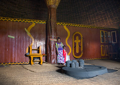 Gurage woman in front of the fireplace inside her traditional house, Gurage Zone, Butajira, Ethiopia (Eric Lafforgue) Tags: abyssinia adult africa architecture art butajira culture decorated decoration depiction developingcountry eastafrica ethiopia ethiopia0617412 ethnic fireplace fulllenght gurage homeinterior horizontal hornofafrica house hut indigenousculture indoors kitchen onepersononly onewomanonly orthodox pilar pots poverty realpeople ruralscene toukoul tradition traditional tribal tukul utensils guragezone et