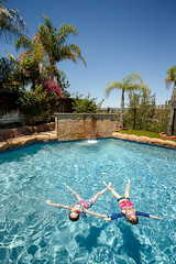 Taking a Break (tltichy) Tags: backyard blue float floating fun girls kids outdoors palmtrees pool socal southerncalifornia summer swimming vacation water