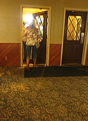 Blurred Exit (AmyEAnderson) Tags: galena illinois resort doorway door doors girl abstract carpet design indoor woman hair flowered pattern blouse swirled wall legs capris open feminine crisscross window windows diagonal mat doormat hotel person walking stepping blonde