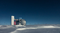 The IceCube Lab in Moon Light (redfurwolf) Tags: southpole antarctica icecubelab icecube snow ice night nightsky building architecture outdoor nature landscape stars flags blue white redfurwolf sony rx100m4