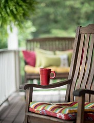 ~Morning's First Cuppa Of Coffee.... (~ Cindy~) Tags: chair rocking railing white bench wooden porch front pillows decorative cup coffee red