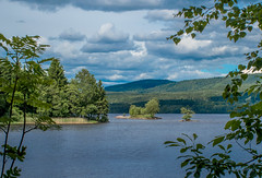 Lake Scenery (bjorbrei) Tags: lake shore water trees branches forest islet islets hills sky clouds maridalen maridaalsvannet oslo norway
