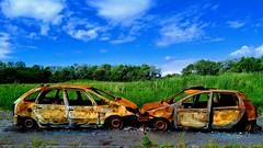 Burns Country - on wasteland near Kilwinning (velton) Tags: ayrshire irvine scotland cars auto fire burnt out