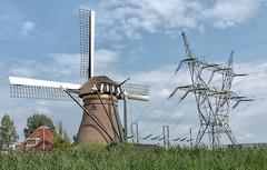 Relatives (Jorden Esser) Tags: nederlandvandaag leiden electricpower electricity powerlines pylon windpower stadsmolen windmill contrast juxtaposition
