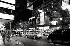 A Thong Lo Friday Night - Bangkok (jcbkk1956) Tags: mono night street thailand bangkok fuji xt1 18mmf2 blackwhite traffic signs pedestrians thonglo worldtrekker