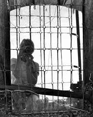 Me, myself, and I (JYB, that's me) Tags: mirror reflection selfportrait wire frame junkyard antiqueshop blackandwhite camera canonrebelt6 canon