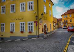On the Corner in Prague, Czech Republic (` Toshio ') Tags: toshio prague czechrepublic czechia restaurant cafe street city europe european europeanunion history fujixe2 xe2 car road architecture yellow