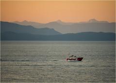 coast guard flying the flag (marneejill) Tags: canadaday canadian flag coast guard salish sea sunset mountains ocean canada