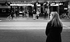 melbourne-8420-bw-ps-w (pw-pix) Tags: woman looking profile face hair coat road street tracks tramtracks bicycle riding rider pedestrians moving walking standing crossing waitingforthelights pedestriancrossing pedestrianlights centreway arcade tafts janai people bikes bicycles poles signs lights bw blackandwhite cold winter morning collinsstreet cbd melbourne victoria australia