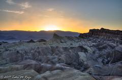 Sunset on the horizon of Zabriskie Point (taharaja) Tags: cactus california deathvalley desert furnacecreek ghosttown jeeping lowestpoint nationalpark offroad oldtown racetrack sealevel zabriskiepoint lakebed movingstones slatflats unitedstates