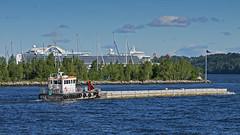 The work boat Signal moving pontoons in Stockholm. The cruise ship Crown Princess in the background. (Franz Airiman) Tags: arbetsbåt workboat bay fjärd lillavärtan lillavärtanbay stockholm sweden scandinavia pontoon flytbrygga signal stockholmshamnar