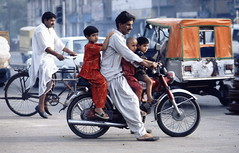 Lahore 1995 - Transport (sharko333) Tags: travel voyage asia asie asien reise pakistan lahore man child vehicle motorcycle portrait street analog 1995