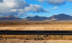 Roadside (RafalZych) Tags: pano panorama canary island islands spain lanzarote road roadside sunset golden hour shadow long shadows fuji fujifilm x100 route black mountain cloud clouds sky