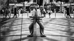 Thumb Workout (Sean Batten) Tags: london england unitedkingdom gb streetphotography street onenewchange blackandwhite bw people reflection window glass city urban nikon df 58mm shoppers texting light shadow