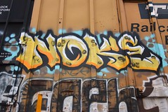 NOKE (TheGraffitiHunters) Tags: graffiti graff spray paint street art colorful freight train tracks benching benched noke floater boxcar ribbet