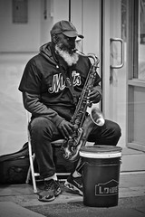 Times Square Jazz (tim.perdue) Tags: nyc street candid person figure man black white bw monochrome new york city vacation metropolis big apple manhattan urban musician saxohpone tenor sax jazz times square midtown entertainment busker sidewalk instrument woodwind