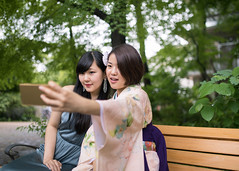 Female graduates taking selfie picture (Apricot Cafe) Tags: img44101 2024years asia asianandindianethnicities japan japaneseethnicity japaneseculture kimono sigma35mmf14dghsmart tokyojapan achievement beautifulwoman bench blackhair brownhair candid carefree celebration ceremony change charming cheerful colorimage communication cultures day dress education friendship garden graduation greencolor hakama happiness horizontal leaning lifeevents lifestyles longdress longhair motivation nature onlyjapanese onlywomen onlyyoungwomen outdoors people photography selfie shorthair sitting sleeveless smartphone smiling student sustainablelifestyle threequarterlength togetherness traditionalclothing twopeople university women youngadult