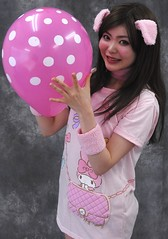 Pretty Pig's Pretend Pop Prank (emotiroi auranaut) Tags: girl woman lady beauty beautiful attractive fetching lovely cute adorable babe pig piggy bunny rabbit ears sneaky mischief mischievous prank trick polkadots big pink toy balloon squeak smirk grin grinning smile smiling asia asian japan japanese