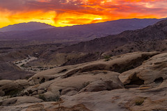Epic Fire In the Sky Sunset Over Martian Landscape (slworking2) Tags: anzaborrego anzaborregodesertstatepark desert california californiastateparks sunset sky clouds windcaves sandstone geology