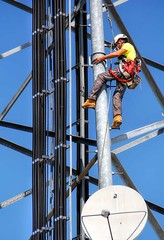 Tower Climber on a Cell Tower in Lewes Delaware (PhotosToArtByMike) Tags: celltowerclimber cell tower worker cellular cellphonetower cellphonetowerclimber hazardousoccupation towerworker telecommunications communication telephone harness