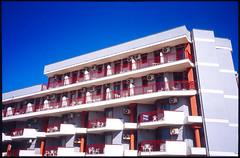Architecture in Alghero (Bourguiboeuf) Tags: canon f1 fuji velvia 100f sardegna color hotel italia design arhitecture sea seaside hostel sky summer holliday geometric
