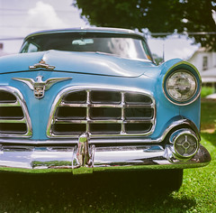 Imperial blue (GmanViz) Tags: gmanviz color car automobile detail 1956 chrysler imperial grille bumper headlight chrome hood film analog 120 6x6 mediumformat hasselblad 500cm zeissplanar80mmf28 fujifilm reala
