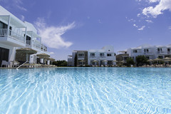 DDH's really large swimming pool (donnicky) Tags: greece kos architecture blue building clouds daylight hotel leisure nopeople outdoor publicsec sky summer swimmingpool travel vacation water