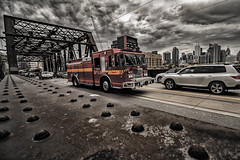 (A Great Capture) Tags: fire truck red storm weather bridge agreatcapture agc wwwagreatcapturecom adjm ash2276 ashleylduffus ald mobilejay jamesmitchell toronto on ontario canada canadian photographer northamerica torontoexplore spring springtime 2017 traffic rivet city downtown lights urban cityscape urbanscape eos digital dslr lens canon t3i rebel street car tracks rail buildings skyline towers tower scenery scenic sky clouds nuvole wolken nubes overcast cloudy outdoor outdoors streetphotography streetscape calle professional firefighters association tpffa the bathurst bolt sir isaac brock steel grey