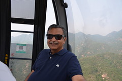 A solo Sri Lankan traveler obliged me by taking this picture inside the cable car (shankar s.) Tags: southeastasia china mainlandchina peking beijing beijingcapitalterritory ancienthistory thegreatwallofchina greatwall badalinggreatwall juyongguanpass defenses barrier mingdynasty tourists crowd path passage ropeway cablecar pod posing selfie